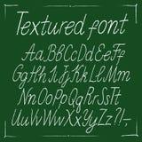 Нарисованный рукой тонкий элегантный текстурированный шрифт каллиграфии Стоковые Изображения
