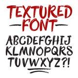 Нарисованный рукой шрифт текстурированный щеткой Стоковая Фотография