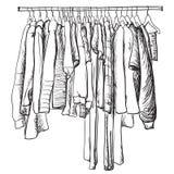 Нарисованный рукой эскиз шкафа Пальто и другие одежды зимы Стоковые Фото