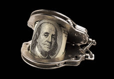 Наручники долларов и полиции стали Стоковое Изображение