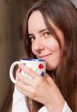 наслаждаться кофе Стоковые Изображения