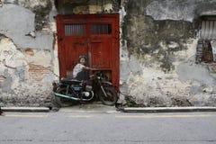 Настенная роспись искусства улицы в Джорджтауне, Penang, Малайзии Стоковая Фотография