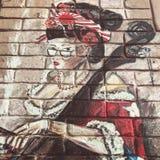 Настенная роспись кубинськой женщины на стене в Kyiv или Киеве, Украине Стоковое Изображение