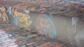 Настенная роспись отраженная в воде Стоковое Фото