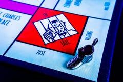 Настольная игра монополии - тюрьма знака внимания ботинка посещая стоковые изображения
