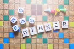 Настольные игры Победитель игры кубы и обломоки игры на холсте Стоковая Фотография