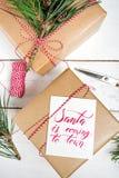 Настоящие моменты коробки подарков рождества на деревянной предпосылке Стоковое Изображение