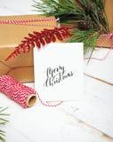 Настоящие моменты коробки подарков рождества на деревянной предпосылке Стоковая Фотография RF