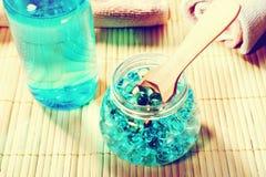 Натюрморт курорта с мылом, солью для принятия ванны, сливк, полотенцем, свечами Стоковые Изображения