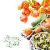 Натюрморт пасхи с оранжевыми тюльпанами и украшениями пасхи Стоковое Изображение RF