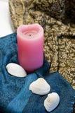 Натюрморт розовой свечи и видит раковины Стоковые Изображения RF