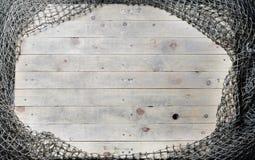 Натюрморт рыболовных сетей на деревянной предпосылке Стоковые Изображения