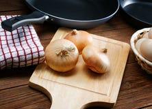 Натюрморт с луками и яичками триперсток Стоковая Фотография RF