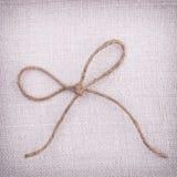 Натянутый лук на предпосылке ткани Стоковые Изображения