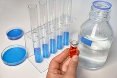 Научная предпосылка в сини, белизне и апельсине Стоковые Фото