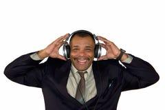 наушники афроамериканца укомплектовывают личным составом усмехаться Стоковая Фотография