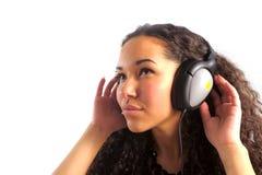 наушники девушки слушают нот к детенышам Стоковые Фотографии RF