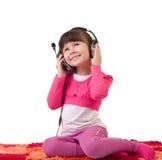 наушники девушки слушают нот к Стоковые Фотографии RF