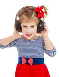наушники девушки слушают нот к Стоковое Изображение RF