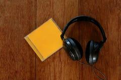 Наушники и компакт-диск Стоковые Фотографии RF