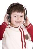 наушники мальчика слушают нот Стоковое фото RF