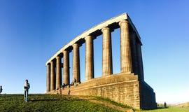 Национальный монумент, туристы, холм Calton, Шотландия Стоковое Фото