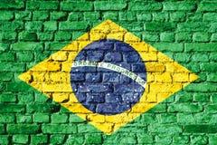 Национальный флаг Бразилии покрашенный на кирпичной стене Стоковые Фото