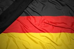 национальный флаг Германии с черной оплакивая лентой Стоковая Фотография RF