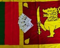 Национальный флаг Шри-Ланка с билетами сверчка стоковое фото rf