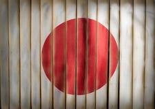 Национальный флаг Японии на бамбуковой древесине Стоковое Фото