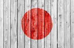 Национальный флаг Японии на старой деревянной предпосылке Стоковые Изображения RF