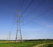 Национальные линии электропередач опор решетки Стоковая Фотография