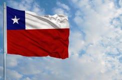 Национальный флаг Чили перед голубым небом Стоковое фото RF