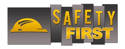 Нашивки безопасность прежде всего желтые черные Стоковая Фотография