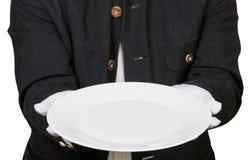 Над взглядом пустой белой плиты в руках в перчатках Стоковые Изображения