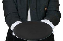 Над взглядом пустой черной плиты в руках в перчатках Стоковые Изображения RF