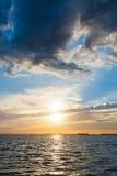 над водой захода солнца Стоковая Фотография