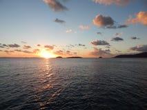 над водой захода солнца Стоковые Фотографии RF