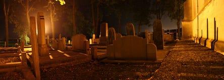 Надгробные камни в погосте Стоковая Фотография