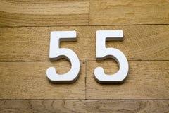 55 на деревянном поле партера Стоковые Изображения