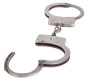 Надевает наручники крупный план на изолированный Стоковая Фотография