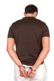 надеванный наручники преступник Стоковые Изображения RF