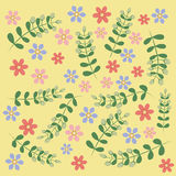 На желтой предпосылке, цветках и хворостинах Стоковые Фотографии RF