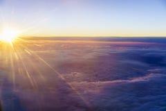 над заходом солнца облаков Стоковые Фото