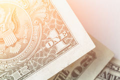 Наличные деньги, деньги, фото конца-вверх, одна банкнота долларовой банкноты в влиянии фильтра солнечного света Стоковые Изображения RF