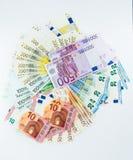 Наличные деньги концепции финансов денег банкноты евро на белой предпосылке Стоковое Изображение