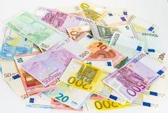 Наличные деньги концепции финансов денег банкноты евро на белой предпосылке Стоковое Фото