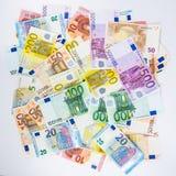 Наличные деньги концепции финансов денег банкноты евро на белой предпосылке Стоковые Фотографии RF
