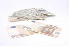 Наличные деньги долларов США и евро Стоковое Изображение