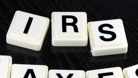 Налоги IRS слова - термина используемая для дела в торговой операции финансов и фондовой биржи сток-видео